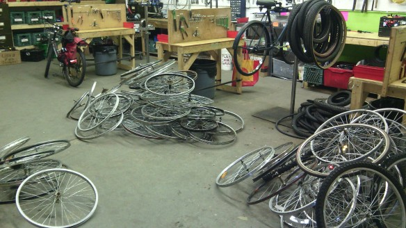Having finished a prolonged drive to strip down the bikes of the lesser water at Bikeworks North, we now have a lot of parts to sort out. This picture shows maybe one fifth of the wheels to be sorted into scrap and keepers.